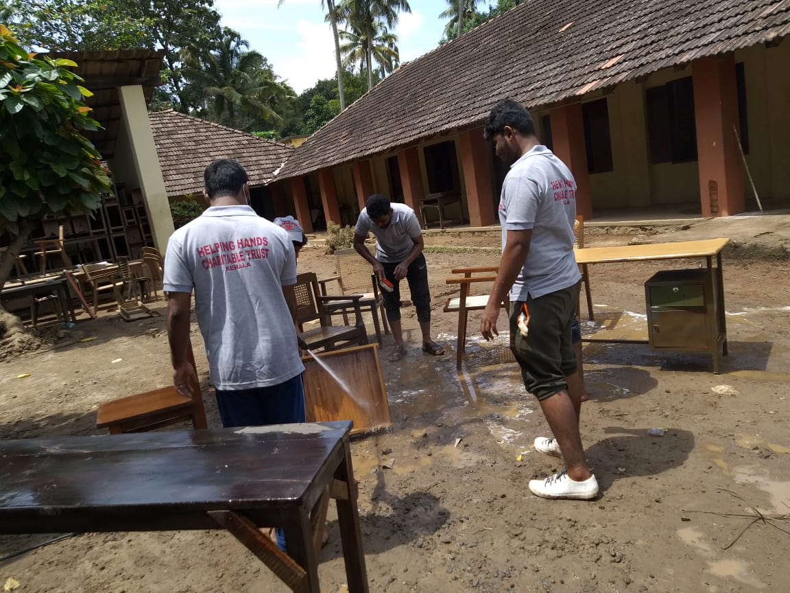 Dr. K. P. Hussain Charitable trust team doing cleaning work at Wayanad flood area.